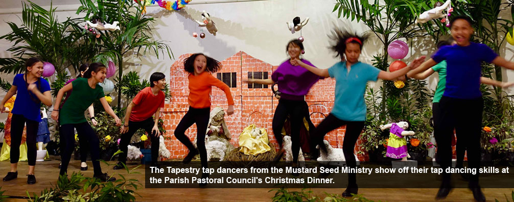 The Tapestry tap dancers from the Mustard Seed Ministry show off their tap dancing skills at the Parish Pastoral Council's Christmas Dinner.
