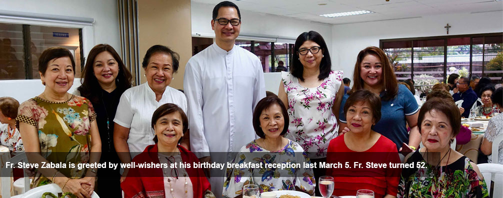 Fr. Steve Zabala is greeted by well-wishers at his birthday breakfast reception last March 5. Fr. Steve turned 52.